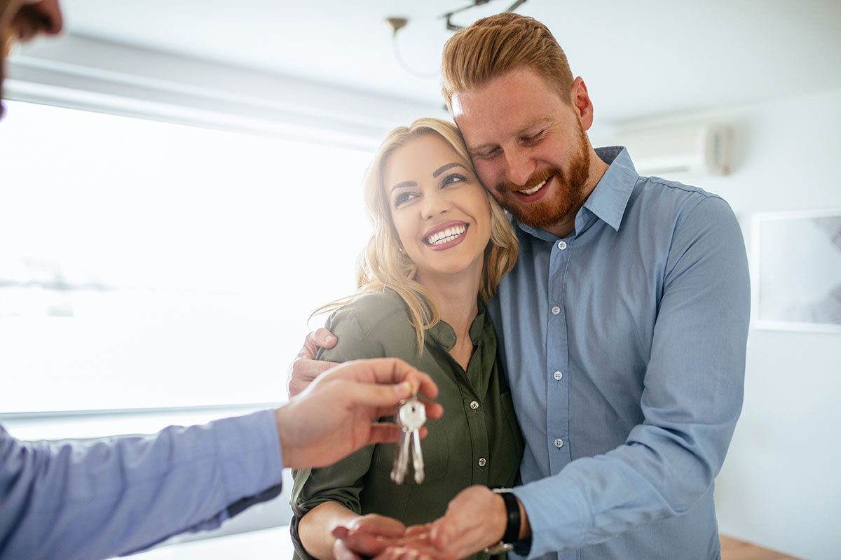 Couple Receiving Keys | Amir Prestige Property Agents Gold Coast
